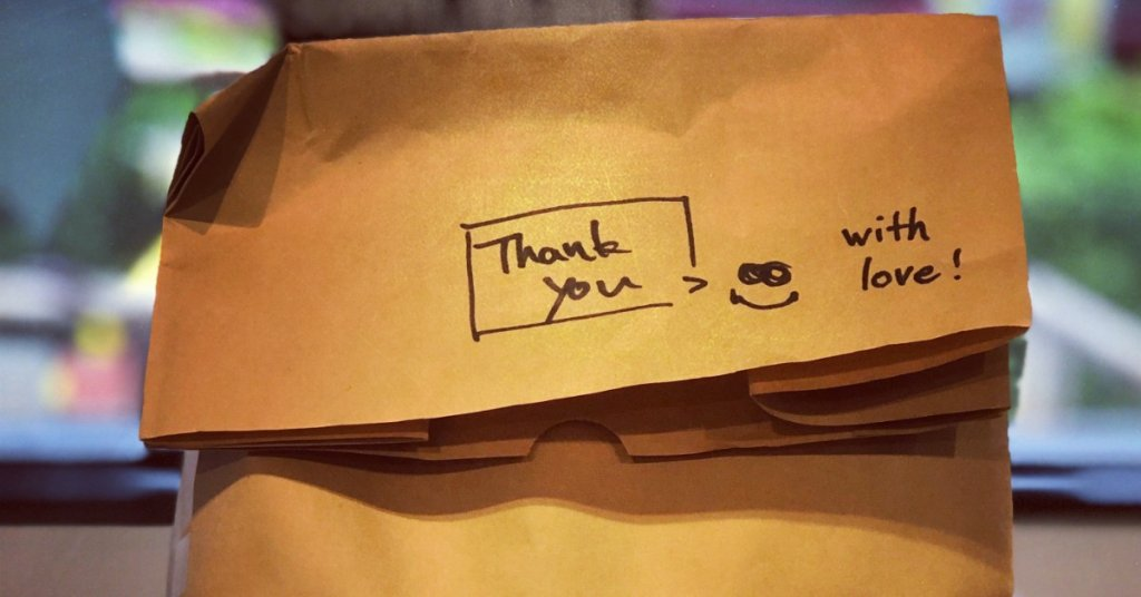 brown paper bag with thank you note
